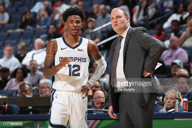 Ja Morant and Taylor Jenkins of the Memphis Grizzlies talk against the Charlotte Hornets during a preseason game on October 14 2019 at FedExForum in...