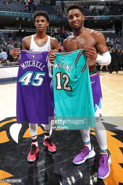 Ja Morant of the Memphis Grizzlies and Donovan Mitchell of the Utah Jazz exchange jerseys after the game on November 29, 2019 at FedExForum in...