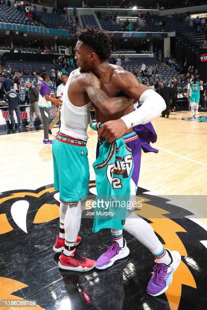 Ja Morant of the Memphis Grizzlies and Donovan Mitchell of the Utah Jazz exchange jerseys after the game on November 29 2019 at FedExForum in Memphis...