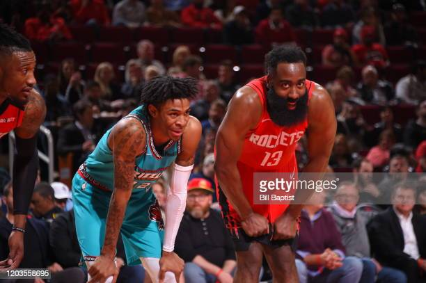 Ja Morant of the Memphis Grizzlies and James Harden of the Houston Rockets smile during the game on February 26 2020 at the Toyota Center in Houston...