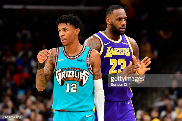 Ja Morant of the Memphis Grizzlies and LeBron James of the Los Angeles Lakers stand on the court at FedExForum on November 23 2019 in Memphis...