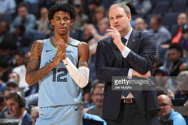Ja Morant of the Memphis Grizzlies and Taylor Jenkins of the Memphis Grizzlies looks on during the game on March 10 2020 at FedExForum in Memphis...