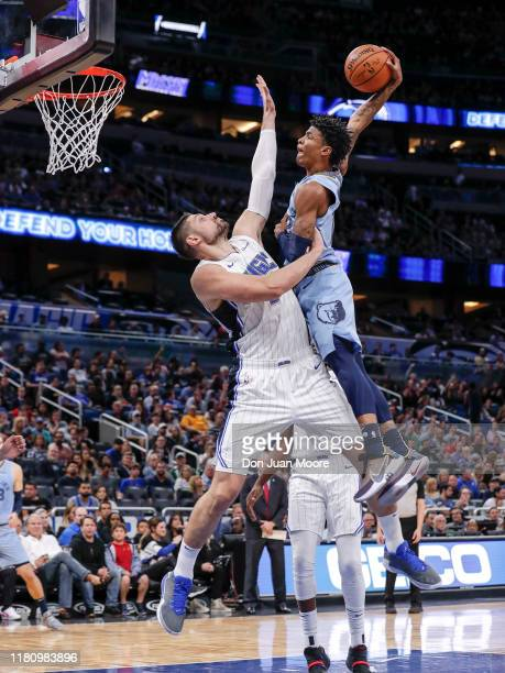 Ja Morant of the Memphis Grizzlies attempts to dunk over Nikola Vucevic of the Orlando Magic during the game at the Amway Center on November 8 2019...
