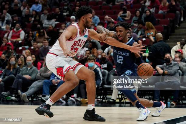 Ja Morant of the Memphis Grizzlies dribbles the ball against Tony Bradley of the Chicago Bulls in the second half during a preseason game at United...