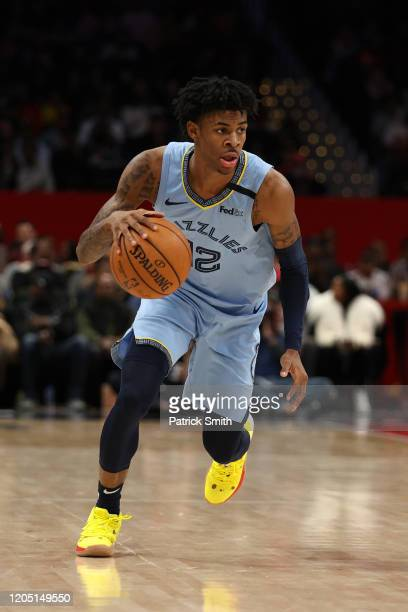 Ja Morant of the Memphis Grizzlies dribbles the ball up the court against the Washington Wizards during the second half at Capital One Arena on...