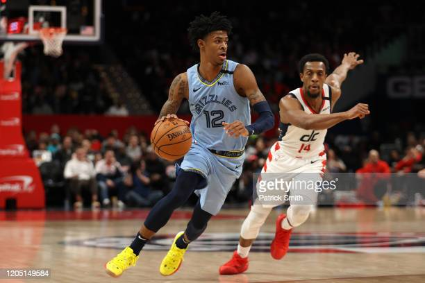 Ja Morant of the Memphis Grizzlies dribbles the ball up the court past Ish Smith of the Washington Wizards during the second half at Capital One...