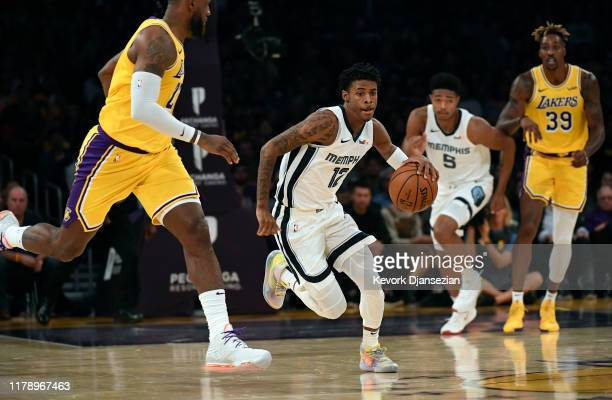 Ja Morant of the Memphis Grizzlies drives against LeBron James of the Los Angeles Lakers during the second half of the basketball game at Staples...