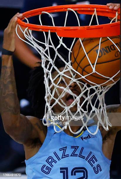 Ja Morant of the Memphis Grizzlies dunks against the Portland Trail Blazers during the fourth quarter in the Western Conference play-in game one at...