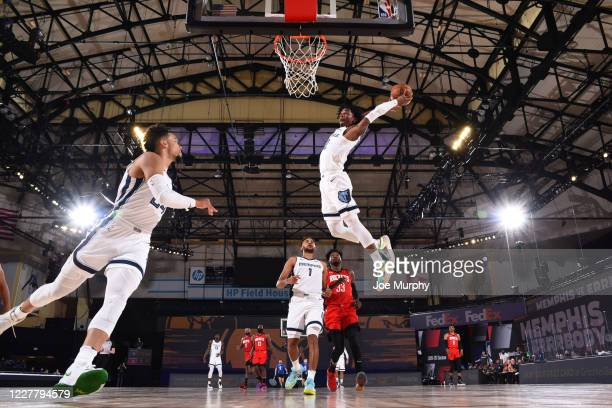 Ja Morant of the Memphis Grizzlies dunks the ball against the Houston Rockets during a scrimmage on July 26, 2020 at HP Field House at ESPN Wide...