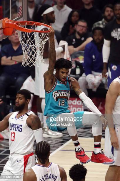 Ja Morant of the Memphis Grizzlies dunks the ball against the Los Angeles Clippers during the first half at Staples Center on February 24, 2020 in...