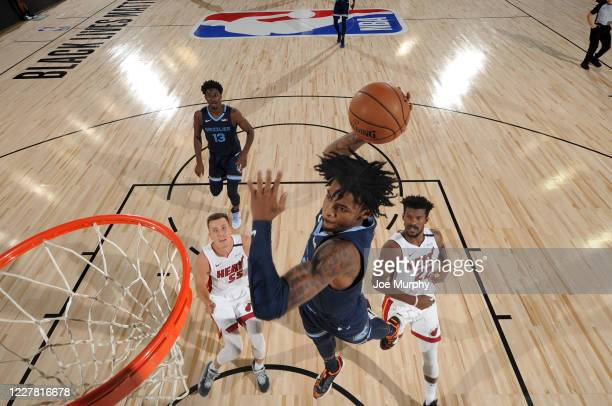 Ja Morant of the Memphis Grizzlies dunks the ball during the game against the Miami Heat during a scrimmage on July 28, 2020 at The Visa Athletic...