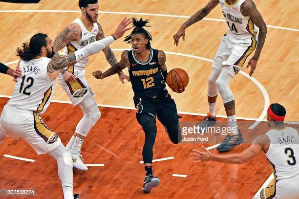 Ja Morant of the Memphis Grizzlies goes to the basket against Steven Adams of the New Orleans Pelicans during the first half at FedExForum on...