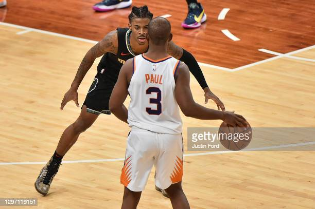 Ja Morant of the Memphis Grizzlies guards Chris Paul of the Phoenix Suns during the second half at FedExForum on January 18, 2021 in Memphis,...