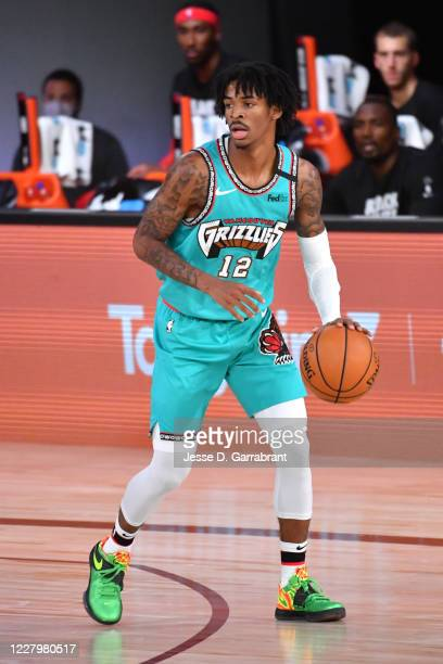Ja Morant of the Memphis Grizzlies handles the ball during the game on August 9, 2020 at Visa Athletic Center at ESPN Wide World of Sports in...
