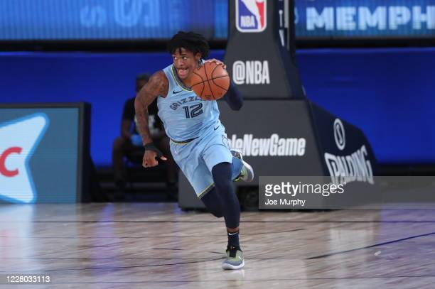 Ja Morant of the Memphis Grizzlies handles the ball during the game against the Milwaukee Bucks on August 13, 2020 at The Visa Athletic Center at...