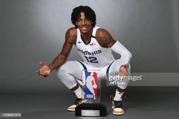 Ja Morant of the Memphis Grizzlies holds the Eddie Gottlieb Trophy for a portrait after being named the 201920 Kia NBA Rookie of the Year on...