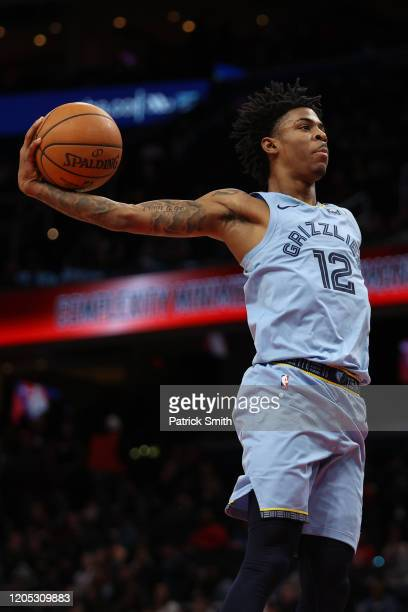 Ja Morant of the Memphis Grizzlies in action against the Washington Wizards during the second half at Capital One Arena on February 9, 2020 in...