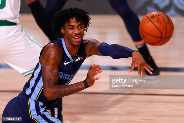 Ja Morant of the Memphis Grizzlies passes the ball during the third quarter against the Boston Celtics at The Arena at ESPN Wide World Of Sports...