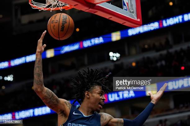 Ja Morant of the Memphis Grizzlies reacts after making a basket against the Chicago Bulls in the second half during a preseason game at United Center...
