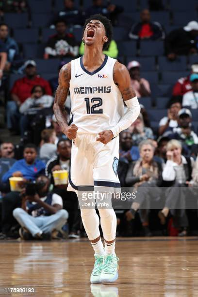 Ja Morant of the Memphis Grizzlies reacts to a play against the Charlotte Hornets during a preseason game on October 14 2019 at FedExForum in Memphis...