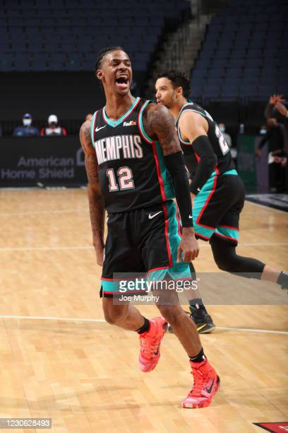 Ja Morant of the Memphis Grizzlies reacts to a play during the game against the Philadelphia 76ers on January 16, 2021 at FedExForum in Memphis,...