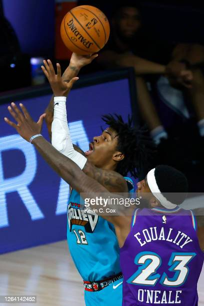 Ja Morant of the Memphis Grizzlies shoots in front of Royce O'Neale of the Utah Jazz during the first half at HP Field House at ESPN Wide World Of...