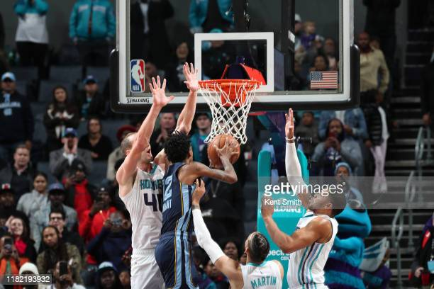 Ja Morant of the Memphis Grizzlies shoots the ball to win the game against the Charlotte Hornets on November 7 2019 at Spectrum Center in Charlotte...