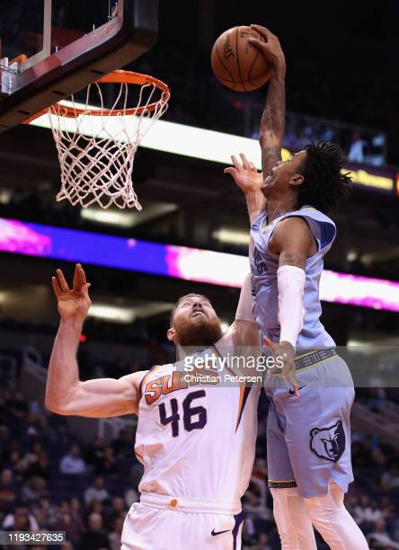 Ja Morant of the Memphis Grizzlies slam dunks the ball over Aron Baynes of the Phoenix Suns during the second half of the NBA game at Talking Stick...