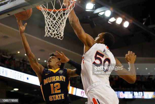 Ja Morant of the Murray State Racers attacks the basket against Austin Wiley of the Auburn Tigers at Auburn Arena on December 22 2018 in Auburn...