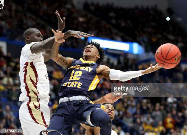 Ja Morant of the Murray State Racers attempts a shot against Christ Koumadje of the Florida State Seminoles in the first half during the second round...