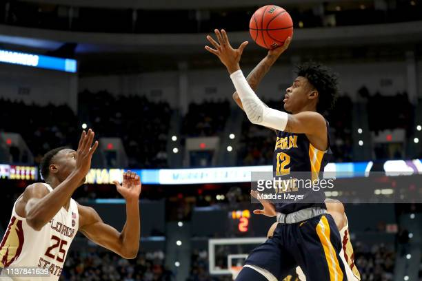 Ja Morant of the Murray State Racers attempts a shot against Mfiondu Kabengele of the Florida State Seminoles in the second half during the second...