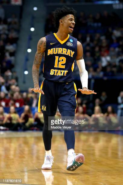 Ja Morant of the Murray State Racers celebrates a three point basket against the Florida State Seminoles in the first half during the second round of...