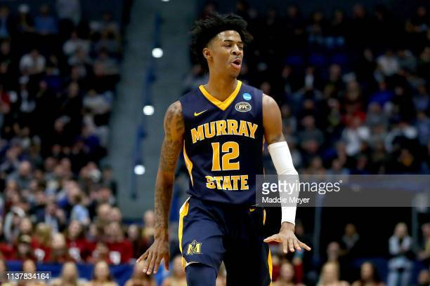 Ja Morant of the Murray State Racers celebrates his three point basket against the Florida State Seminoles in the first half during the second round...