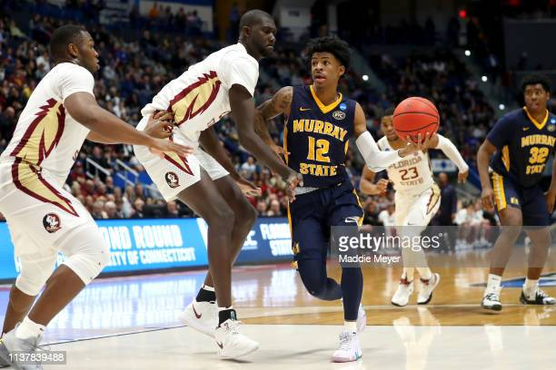 Ja Morant of the Murray State Racers drives to the basket against Christ Koumadje of the Florida State Seminoles in the second half during the second...