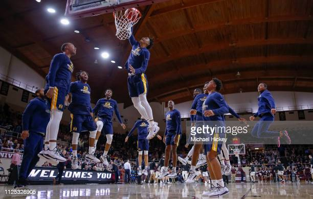 Ja Morant of the Murray State Racers dunks the ball during warmups as his teammates watch before the game against the Eastern Kentucky Colonels at...