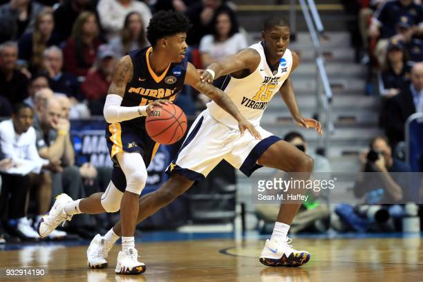 Ja Morant of the Murray State Racers handles the ball against Lamont West of the West Virginia Mountaineers in the first half during the first round...