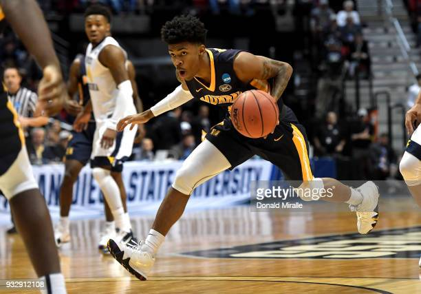 Ja Morant of the Murray State Racers handles the ball in the first half against the West Virginia Mountaineers during the first round of the 2018...