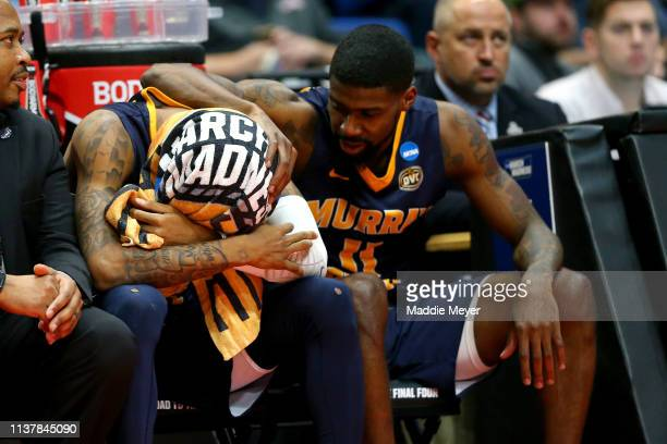 Ja Morant of the Murray State Racers is consoled by teammate Shaq Buchanan as he reacts late in the game of his teams loss to the Florida State...