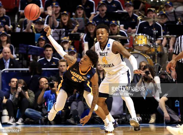 Ja Morant of the Murray State Racers reaches for a loose ball against Brion Sanchious of the Murray State Racers in the first half during the first...