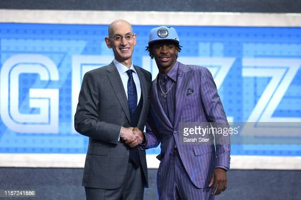 Ja Morant poses with NBA Commissioner Adam Silver after being drafted with the second overall pick by the Memphis Grizzlies during the 2019 NBA Draft...