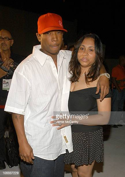 Ja Rule and Aisha Atkins during Olympus Fashion Week Spring 2005 Baby Phat Front Row at Skylight Studio in New York City New York United States
