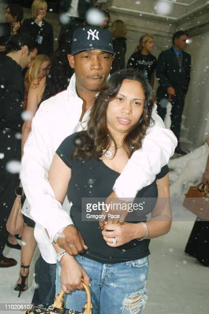 Ja Rule and Aisha Atkins during The Day After Tomorrow New York Premiere Arrivals at American Museum of Natural History in New York City New York...