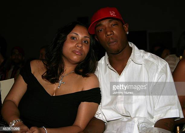 Ja Rule and his wife Aisha Atkins during Olympus Fashion Week Spring 2005 Baby Phat Front Row at Skylight Studio in New York City New York United...