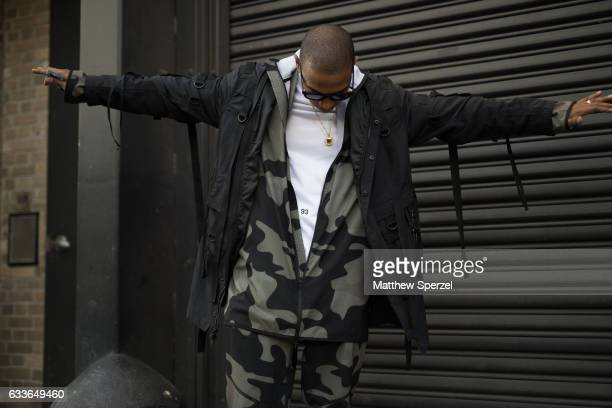 Ja Rule is seen attending Stampd/Willy Chavarria/Orley while wearing a camoflauge suit with white shirt and black coat on February 2 2017 in New York...