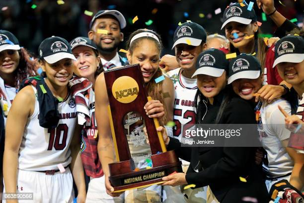 A'ja Wilson and head coach Dawn Staley of the South Carolina Gamecocks hold the NCAA trophy and celebrates with their team after winning the...