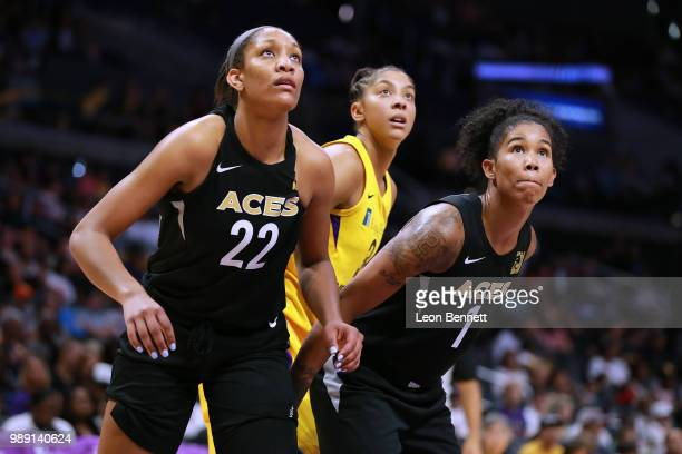 A'ja Wilson and Tamera Young of the Las Vegas Aces box out Candace Parker of the Los Angeles Sparks during a WNBA basketball game at Staples Center...