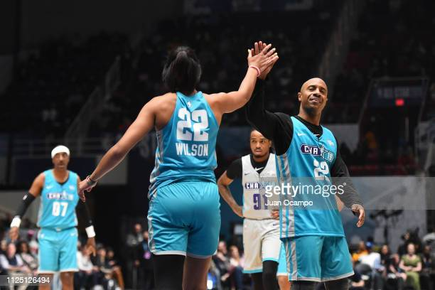 A'ja Wilson high fives Jay Williams of Team Home during the 2019 NBA AllStar Celebrity Game on February 15 2019 at Bojangles Coliseum in Charlotte...