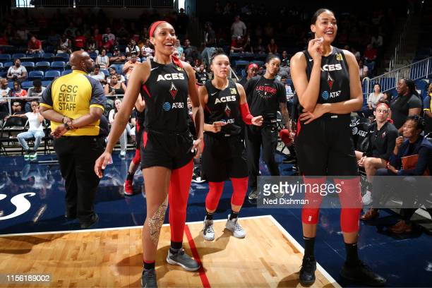 A'ja Wilson Kayla McBride and Liz Cambage of the Las Vegas Aces look on before the game against the Washington Mystics on July 13 2019 at the St...