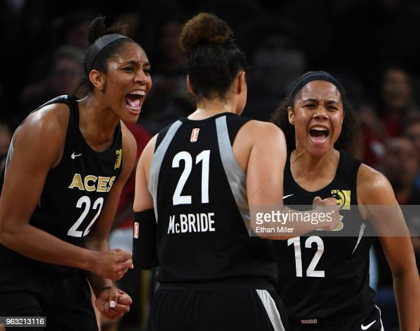 A'ja Wilson Kayla McBride and Nia Coffey of the Las Vegas Aces react after Coffey scored and was fouled by a Seattle Storm player during the Aces'...