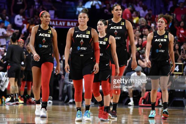 A'ja Wilson Kayla McBride Kelsey Plum Liz Cambage and Dearica Hamby of the Las Vegas Aces are seen walking on the court against the Los Angeles...